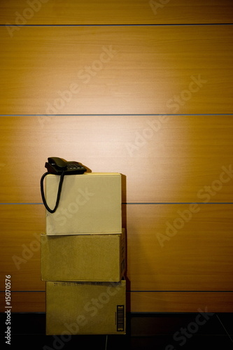 Telephone on cardboard boxes in office