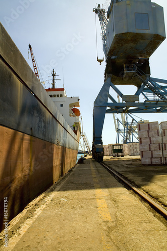 Limassol, Cyprus. Crane loading a freighter with cargo on quayside