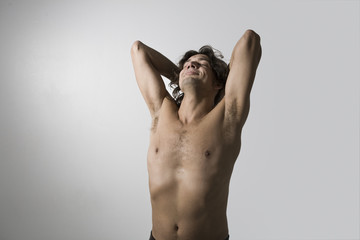 Barechested mid-adult man