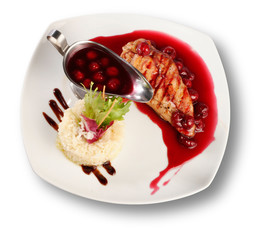 Delicious beef with cherry sauce. File includes clipping path