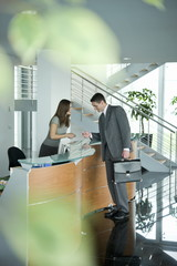 Businessman at reception desk