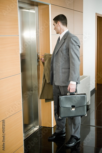 Businessman waiting for the elevator