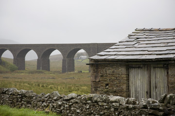 Old shed and viaduct, Yorkshire Dales, Yorkshire, England