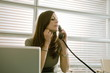 Businesswoman on telephone at desk
