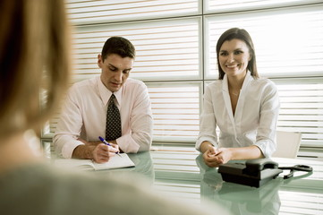 Business people interviewing professional woman