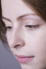 Pensive young woman, close-up