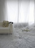 Room covered in transparent dust sheets in preparation for decorating