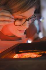 Artist examining textiles, close-up