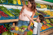 Shopping series - Woman with child buying vegetable