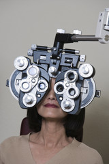 Patient having eyes examined