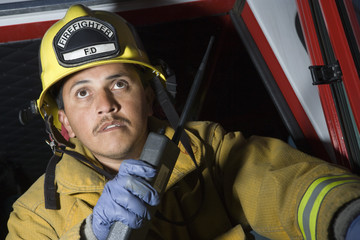 firefighter with two-way radio