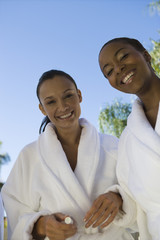Portrait of two women in bathrobes at health spa