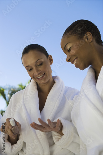 Two women in bathrobes at health spa