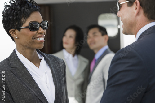 Mid-adult businesswoman and businessman talking.