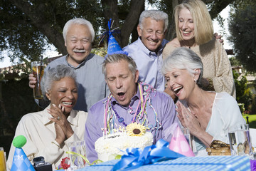 Senior couples celebrating birthday party in garden