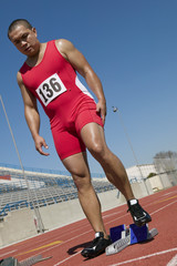 Male sprinter preparing to start