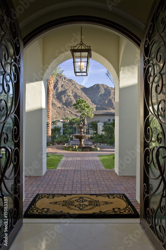 Entrance hall in elegant house, door opened