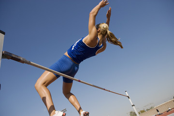 female athlete high-jumping  low angle view