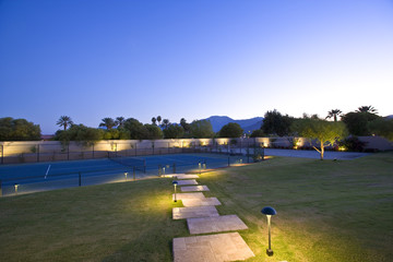 Illuminated lawn and tennis court