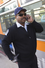 Bus driver using mobile phone by bus