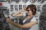 Young woman shopping for sunglasses