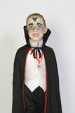 Portrait of boy 7-9 wearing dracula costume for Halloween