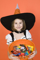 Portrait of girl 7-9 wearing witch costume for Halloween