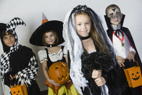 Portrait of boys and girls 7-9 wearing Halloween costumes
