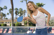 Young woman playing table tennis, portrait