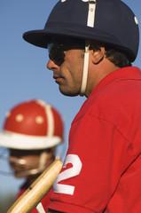 Polo player wearing helmet