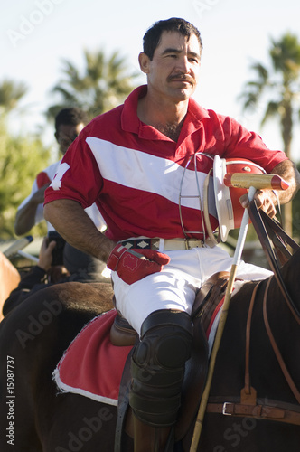 Polo player horseback riding