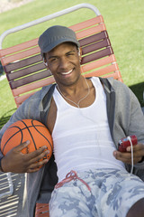 Young Man Holding Basketball, Portrait
