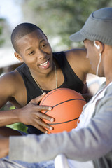 Two Young Men with Basketball, Talking