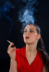 woman with cigarette in cloud of smoke