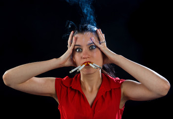 woman with four cigarettes in cloud of smoke