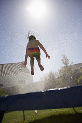 South Africa, Cape Town, girl jumping on trampoline