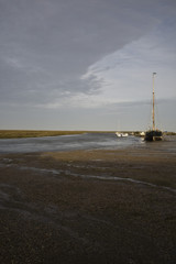 UK, Norfolk, sailboat in bay
