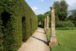 decorative path/ entry with columns & arched topiary hedge