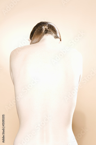 Young womans naked back