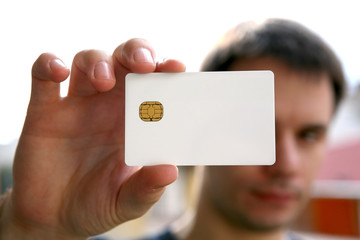man holding a blank id card with chip