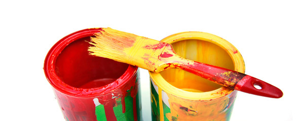 red and yellow cans with paint over white