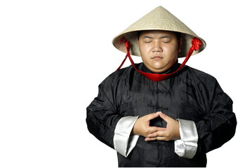 Traditional asian man meditating with conical straw hat