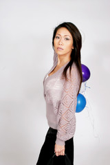 Lovely woman with party balloons