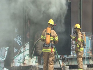 Firemen putting out a fire in a railway car