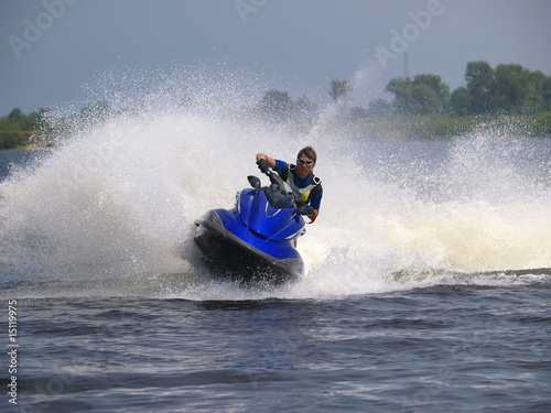 Man on Wave Runner on the water - 15119975