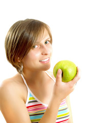 Smiling girl with a green apple