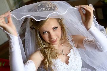 Young beautiful bride under vail