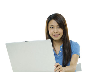 A pretty asian woman working on the laptop