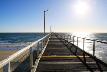 Long Wooden Jetty in Strong Sunlight. Largs Bay Jetty, Adelaide,