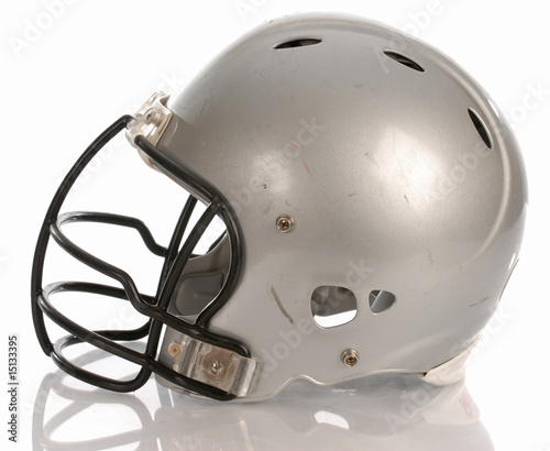 scratched football helmet with reflection
